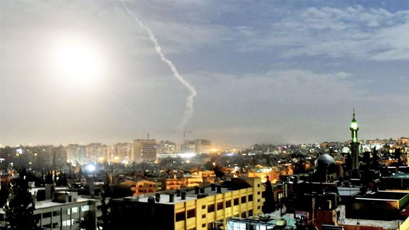 Missiles were seen flying over Damascus near the capital's international airport on Monday [SANA via AP]