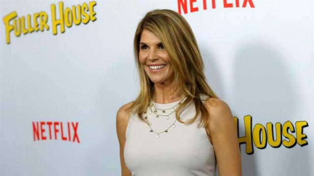 Cast member Lori Loughlin poses at the premiere for the Netflix TV series Fuller House at The Grove in Los Angeles, US, February 16, 2016 [File: Mario Anzuoni/Reuters]