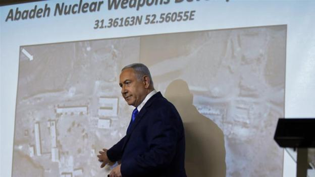 Benjamin Netanyahu shows the media an alleged Iranian nuclear weapons facility on Monday [Menahem Kahana/AFP]