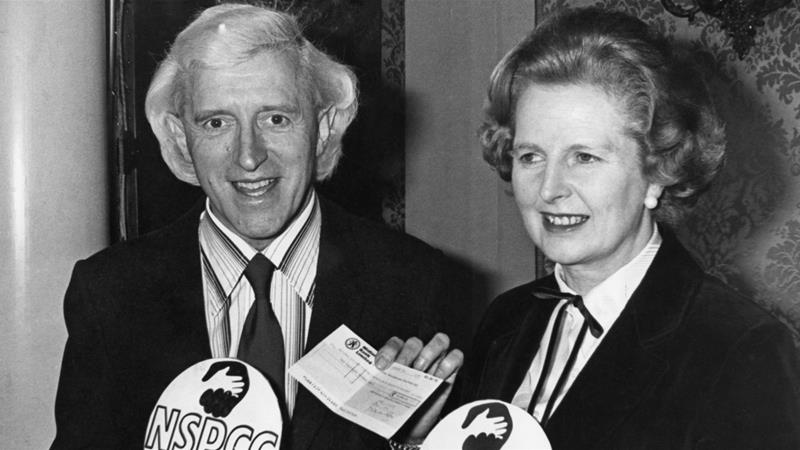 Prime Minister Margaret Thatcher pushed for a knighthood for serial child sex abuser Jimmy Savile, seen here together at a 1980 fundraising event for the National Society for the Prevention of Cruelty to Children [Evening Standard/Hulton Archive/Getty Images]