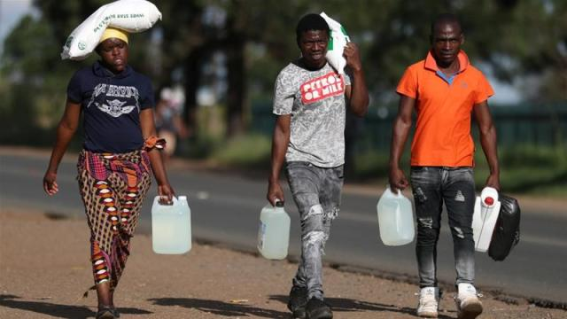 South Africans stocked up on food, alcohol and other supplies before the lockdown started [Siphiwe Sibeko/Reuters]