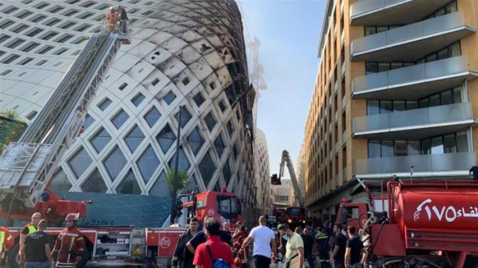 It was not immediately clear what caused the fire in the oval-shaped building [Ahmad el Kerdi/Reuters]