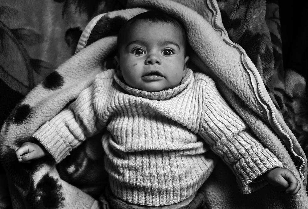 Hajer, three months old, arrived from the village of Inkhil in Dara\(***)a.