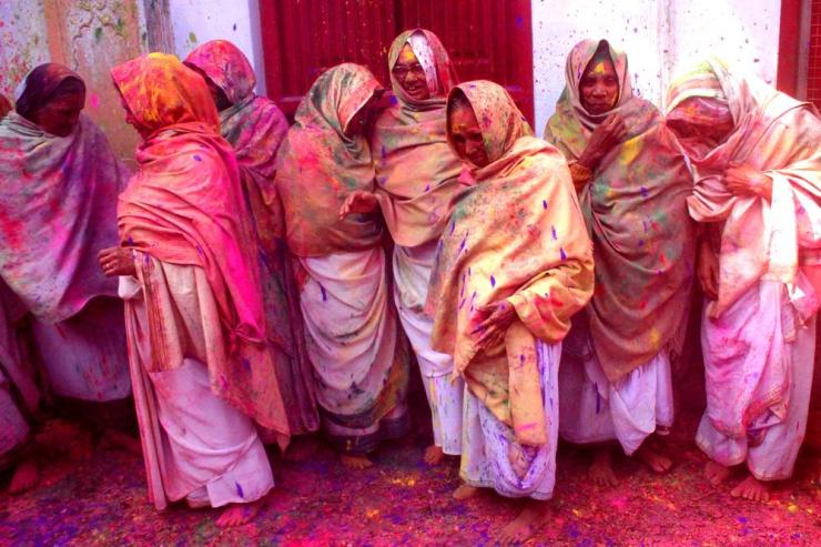 Indian widows celebrating Hindu Holi festival