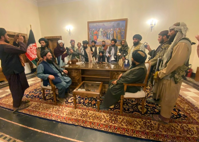 Taliban fighters take control of the Afghan presidential palace after Afghan President Ashraf Ghani fled the country. [Zabi Karimi/AP Photo]
