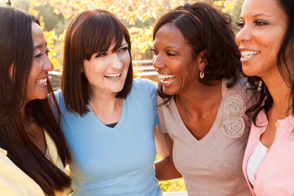 group of women laughing together
