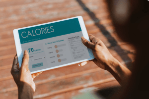 a person looking at a screen showing calories