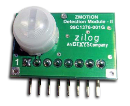An example lens-sensor-microcontroller infrared motion detector assembly. This assembly is from Zilog. The lens and sensor are on top of the board. The microcontroller is underneath the sensor.