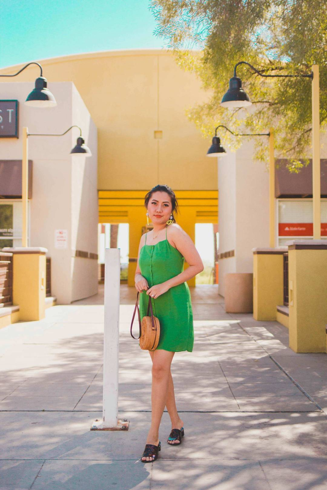 Fashion Style Blogger Molly Larsen form Allaboutgoodvibes.com wearing Inexpensive Summer Dress in Green standing in front of Yellow building