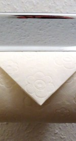 Toilet paper triangle fold
