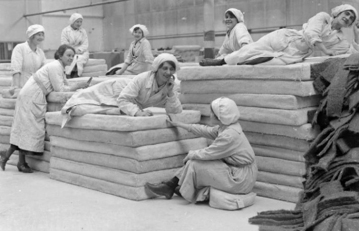 Female workers lie on mattresses