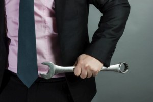 Business man with wrench