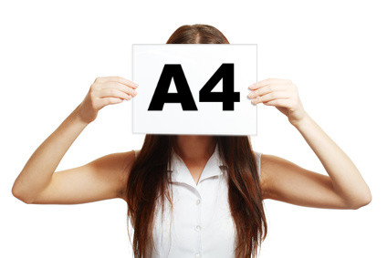 Woman holding a blank A4 page
