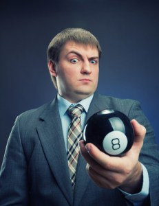 Businessman holding magic ball with number 8
