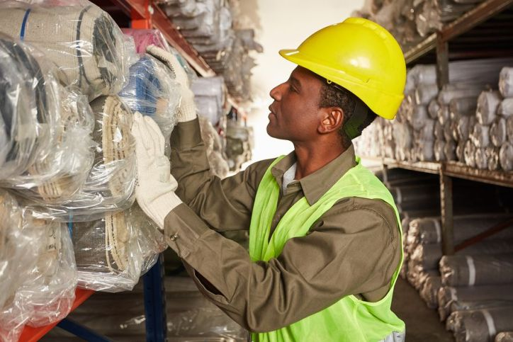 Worker checking inventory