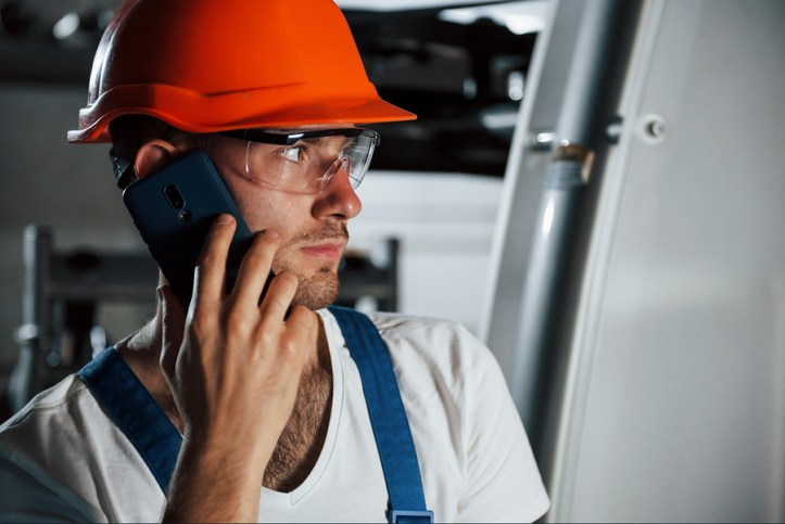 Worker in Factory making a Phone Call
