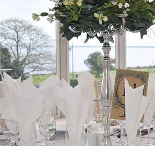 Centrepiece and top table decor by All About Weddings  at The Haven Hotel, Dunmore East, Waterford
