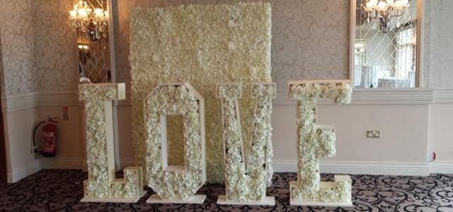 floral LOVE letters and flower wall