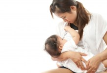 A woman breastfeeding/freedigitalphotos