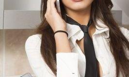 Girl talking over phone/freedigitalphotos