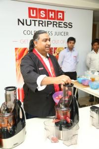 Chef Sanjay demonstrating the juicer