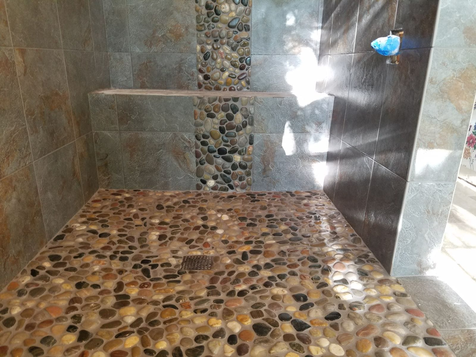 how to install river rock tiles for