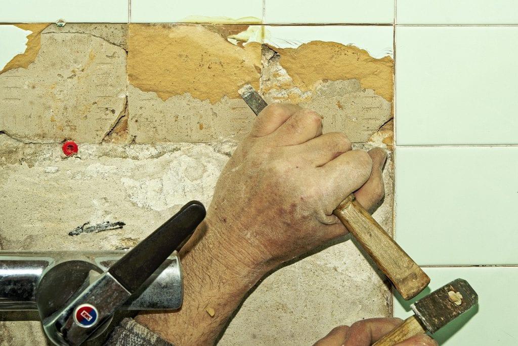 old ceramic floor tiles from concrete floor