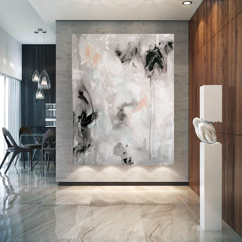 black,white and grey contemporary wall art hanging in a luxury hallway
