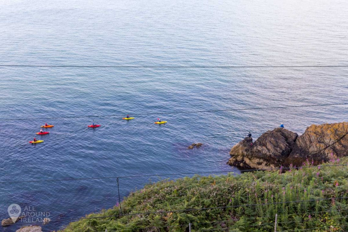 Kayakers in the water along the Bray to Greystones cliff walk