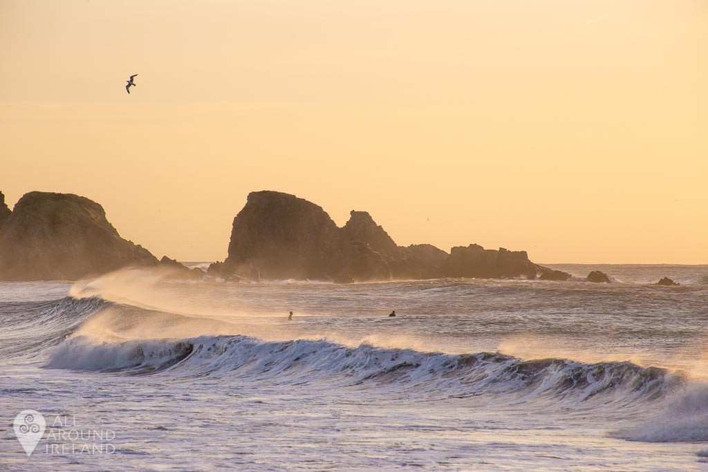 Surfers at Bunmahon Beach on Waterford's Copper Coast.