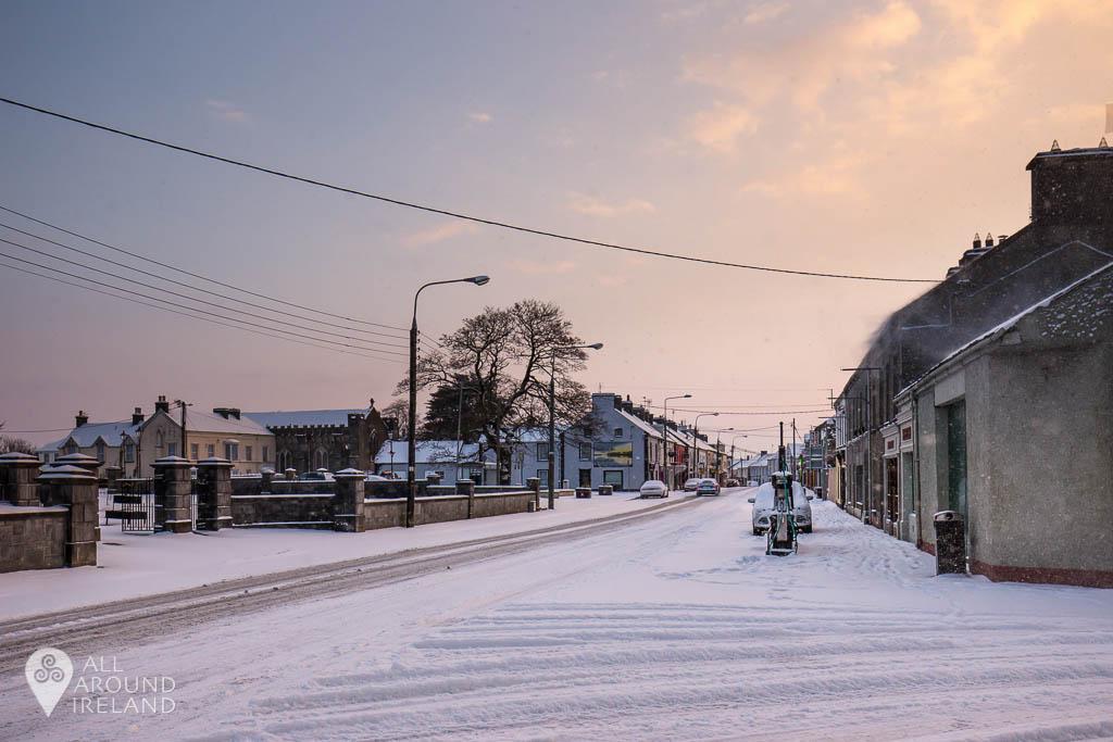 Looking down a snowy St Brendan's Street
