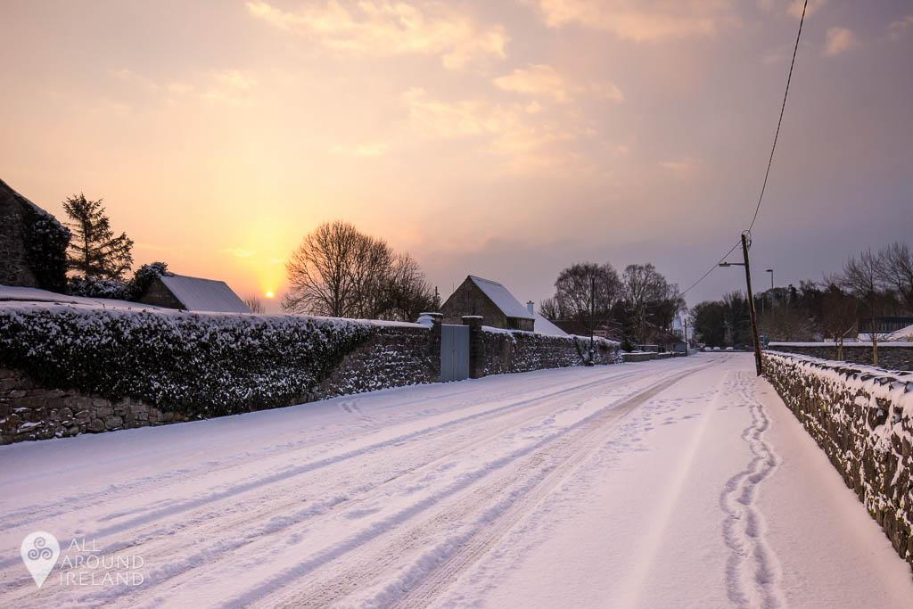 Snow covers Castle Avenue Portumna, as the sun rises