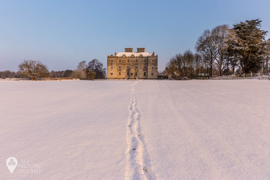 A trail of footsteps in the snow leading to Portumna Castle