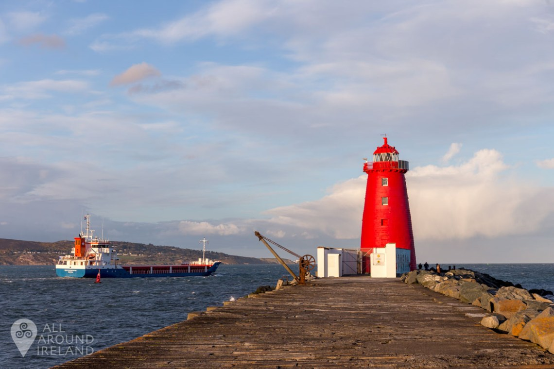 Cargo ship passing the lighthouse