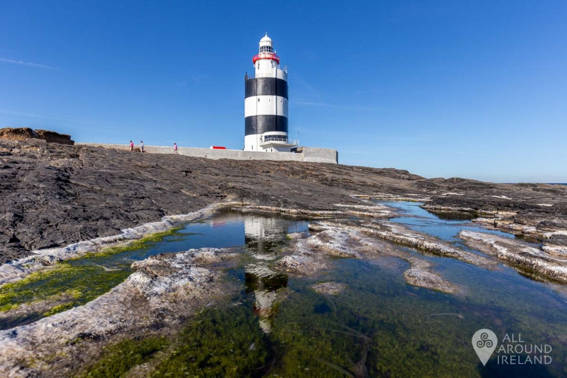 Hook lighthouse reflected in the rock pools. Hook peninsula.