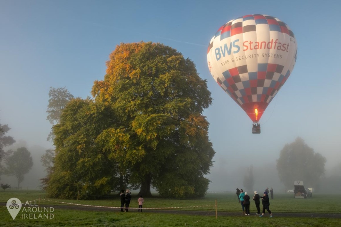 People watch as a hot air balloon launches from the grounds of Birr Castle. Irish Hot Air Ballooning Championships 2018.