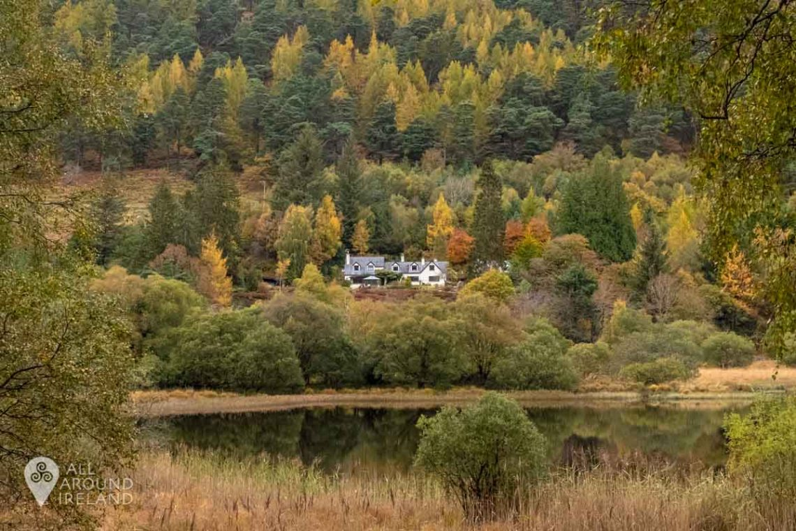 A house surrounded by autumnal trees in Glendalough