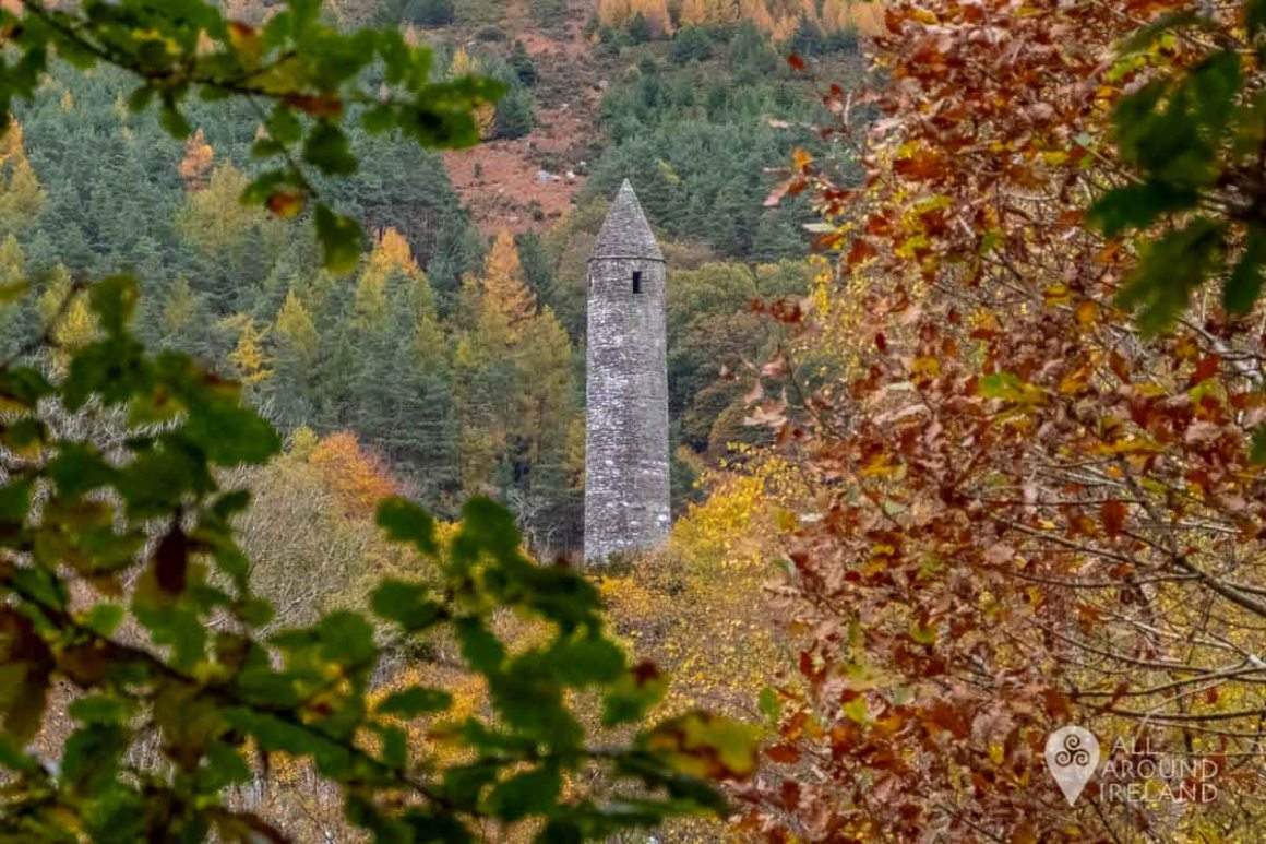 The round tower at Glenalough viewed through the trees.