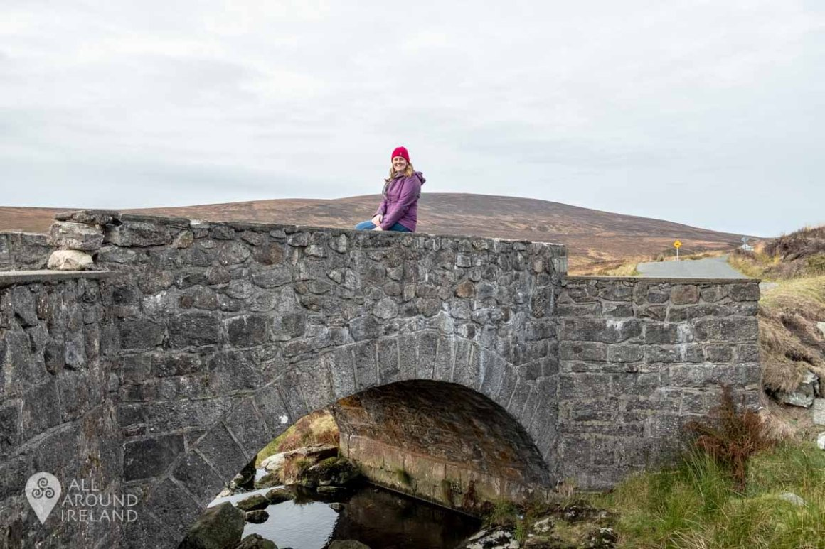 Sitting on the PS I love You Bridge in Wicklow Mountains National Park