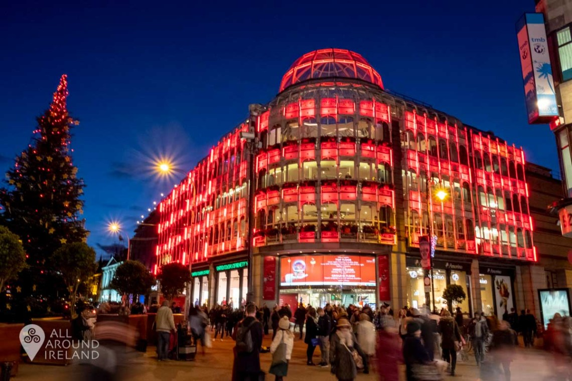 Stephen's Green Shopping Centre illuminated in red for Christmas in Dublin.