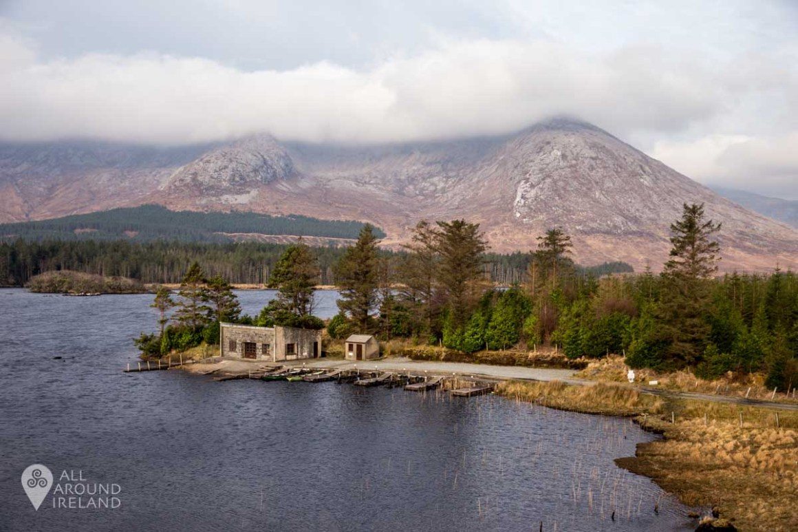 The boathouse at Lough Inagh with the Twelve Bens in the background.