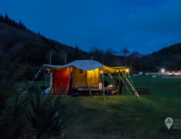 Bosca Beatha mobile sauna lit up at dusk in Glenmalure Valley