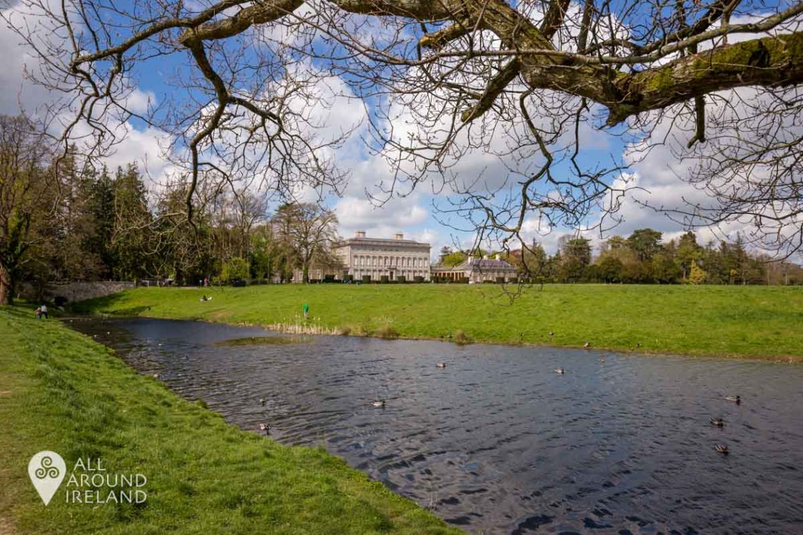 Looking back at Castletown house from the lakeside on a sunny day