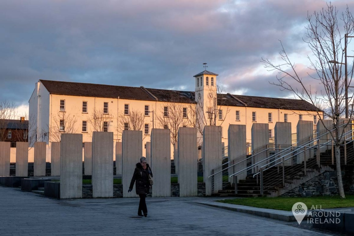 A woman walks through Ebrington Square in Derry