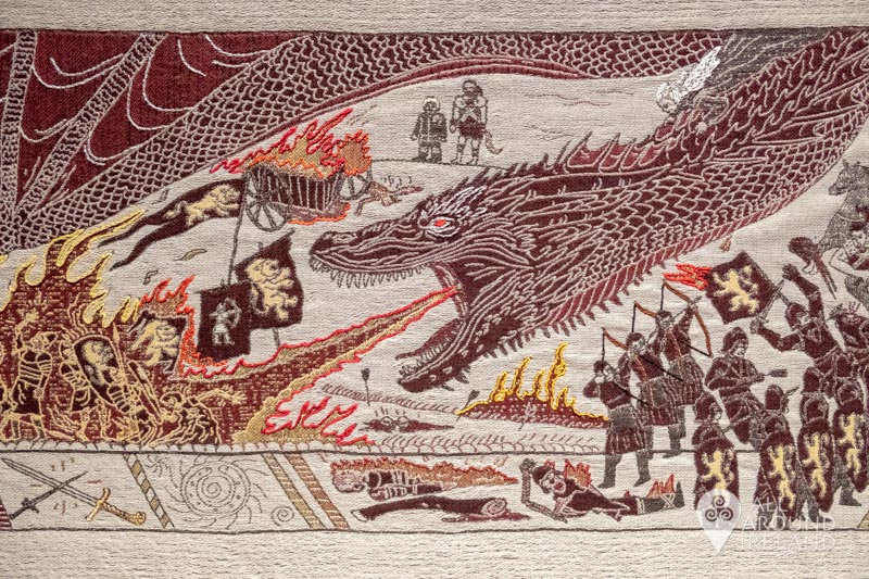An image of a fire breathing dragon on the Game of Thrones tapestry at the Ulster Museum