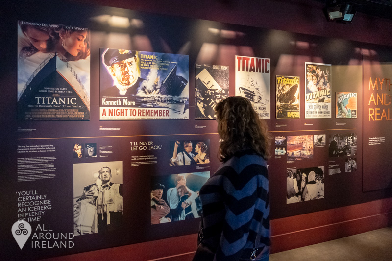 A woman reading one of the displays in the Titanic Experience
