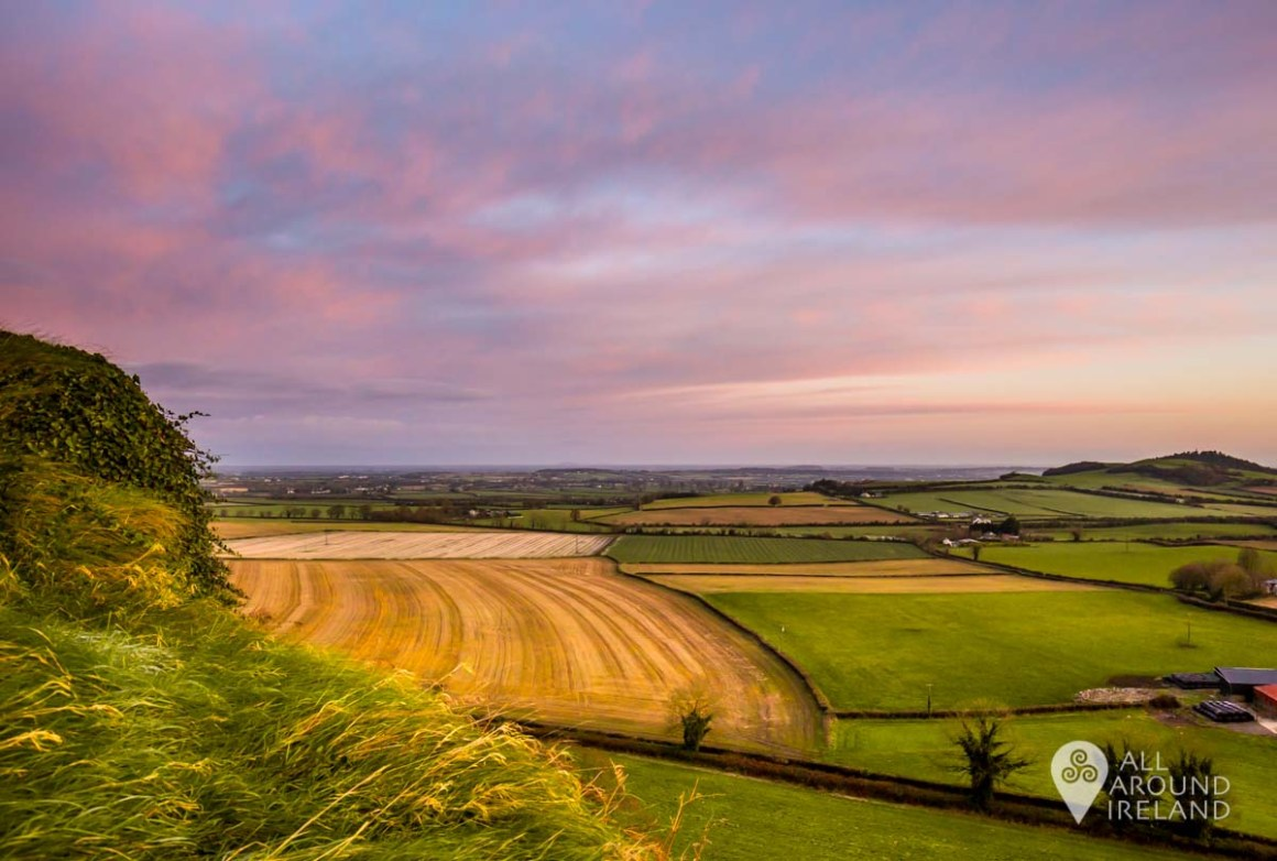 Pink sunrise over the surrounding plains from the top of the Rock of Dunamase