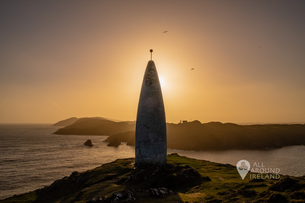 Silhouette of the Baltimore Beacon and Sherkin Island as the sun sets.