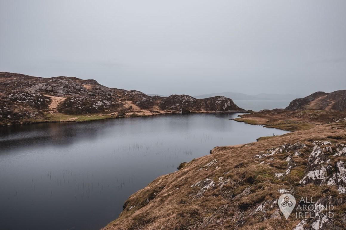 Looking across Dunlough lake towards Dunmanus Bay