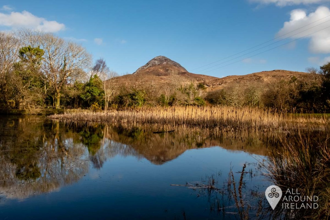 National parks in Ireland. Diamond hill reflected in the lake by the visitor centre.